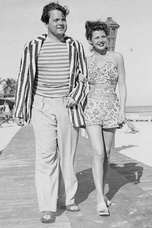 Rita Hayworth and Orson Welles strolling along the boardwalk in Miami Beach, 1944.