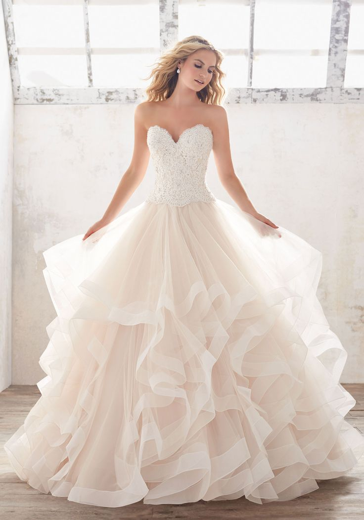 Morilee by Madeline Gardner 'Marcia' 8116 | Soft and Ethereal, Ruffled Bridal Ballgown Features a Crystal Beaded Alençon Lace Bodice, and Horsehair Trimmed Flounced Tulle Skirt. Covered Button Detail Along Back.