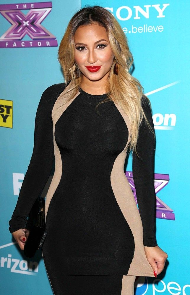 The beautiful Adrienne Bailon ...Dapper ideal Lady... Starting in 2007, Bailon began dating Rob Kardashian, the brother of Kim Kardashian. While dating Rob, Bailon appeared in a total of eight episodes of the reality series Keeping Up with the Kardashians, appearing as Rob's girlfriend