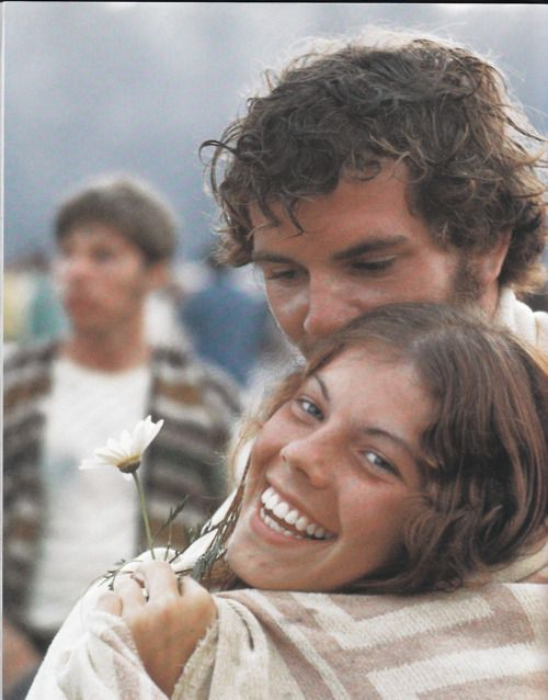 american-nostalgia:           Making love, not war: Sharing a blanket, a flower, and a certain careless rapture, a tousled couple let their love shine at Woodstock.
