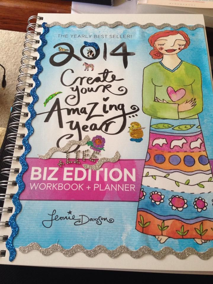 The appropriately glittered, stickered and decorated cover of my shiny new 2014 planner.  This year?  Will be AWESOME!  -- (aff link goes to where you can get @Leonie Bosklopper Dawson :: LeonieDawson.com 's awesome planners if you're interested!)