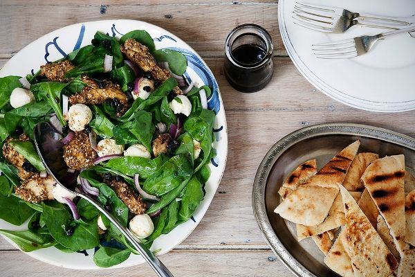 Dukkah crusted morsels of chicken with labneh, baby spinach and a zingy dressing. @Michal Koppa.co.nz