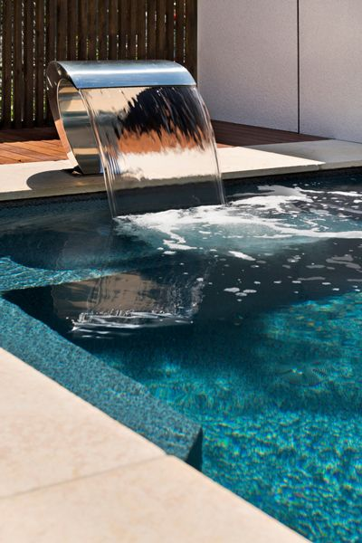 The Classique Courtyard Series Pool by Albatross Pools featuring a Stainless Steel Water Curtain at the Dandenong Display Centre.