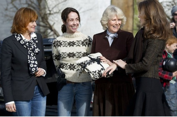 Camilla, Duchess of Cornwall receives a G cardigan