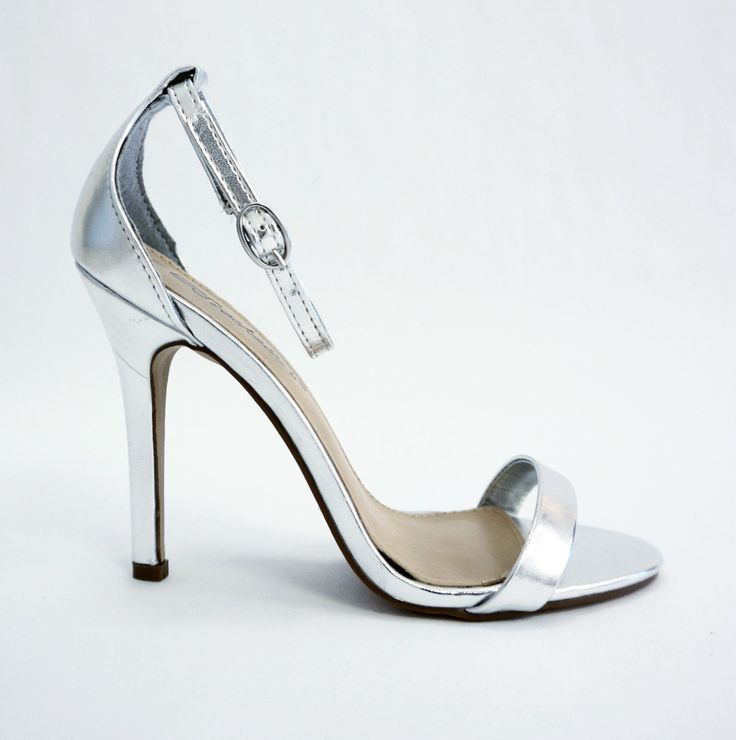 This strappy silver metallic heel is the perfect pop of glitz and glam to put…