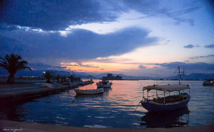 The sun says goodbye to the floating boats.. in Nafpio - Peloponnese - Greece