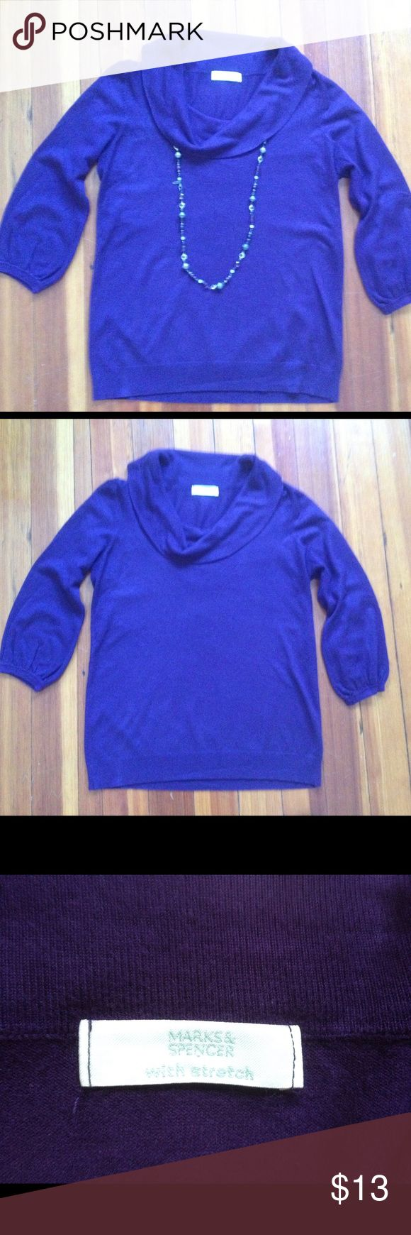 Marks & Spencer Purple Cowl Neck Sweater 3/4 sleeve stretchy cowl neck sweater. My camera wouldn't capture the color well; it's actually a deep plum purple color (seen best in the third picture). Looks great with a pair of black or gray pants for work, or with a pair of jeans and heels for a night out. UK size 12, fits like a US small. Marks & Spencer  Sweaters Cowl & Turtlenecks