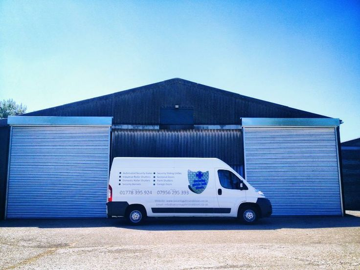 Security Gates and Doors van alongside two roller shutters.