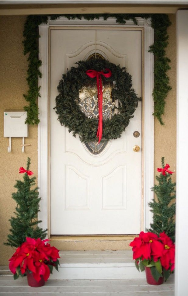 Decorating. Beauteous Christmas Wreath Front Door Inspiration Decoration. Contemporary Front Porch Christmas Decorating Featuring Round Green Christmas Wreath And Red Bows Center And Garland Cones Together With Red Flower In Porch