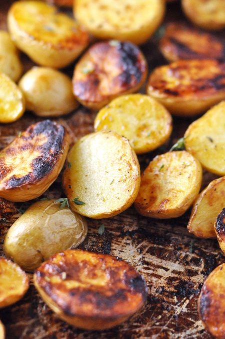 Roasted Salt 'n' Vinegar Baby Potatoes.... very good!  I didn't leave them marinating in the vinegar as long as recipe recommended, had some vinegar flavor but next time will leave in the full 20 min or so for extra tang.