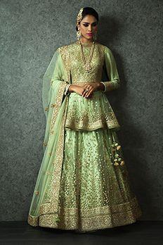 Net lehenga with peplum blouse and net dupatta embellished with zari and sequins from #Benzer #Benzerworld #weddingwearforwomen #ghagracholi #bridalwear #ethnicwear