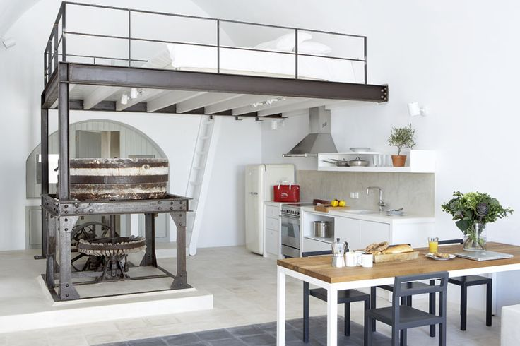 An old factory turned modern dream house on the Greek island Santorini. Make  sure to open the link to see the views!