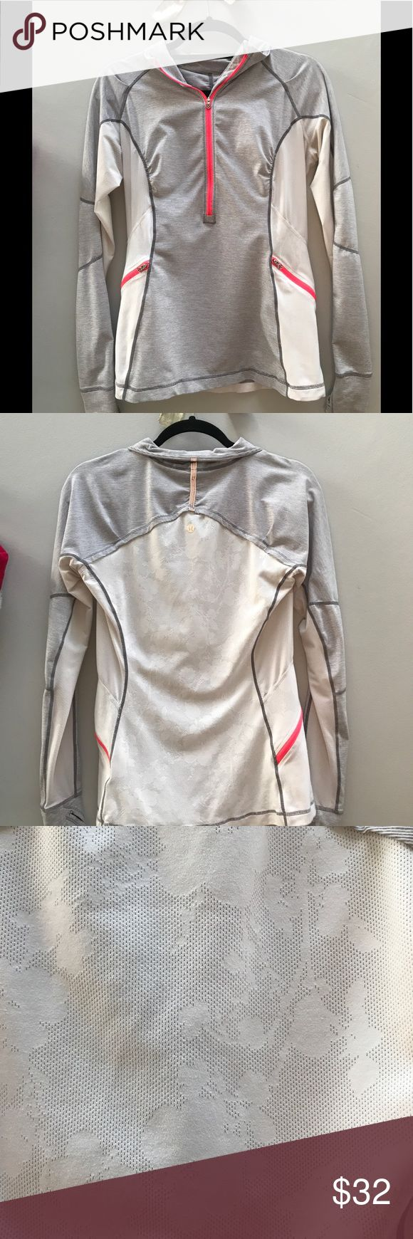 Lululemon pullover White grey and pink Size 8 White laser flower print on back Small discoloration under arms shown in pics- not noticeable when wearing lululemon athletica Tops