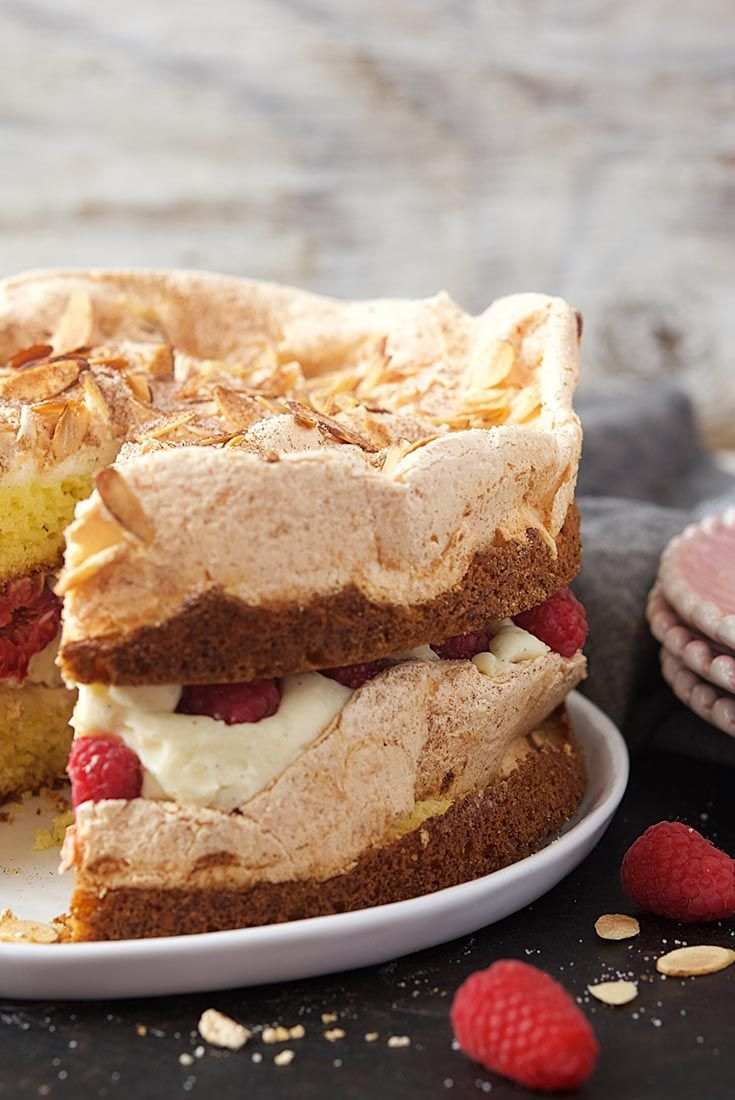 Layers of dense yellow cake topped with meringue, cinnamon, and nuts; and a rich, creamy filling studded with fresh berries. Berry Blitz Torte Recipe - King Arthur Flour May Bakealong