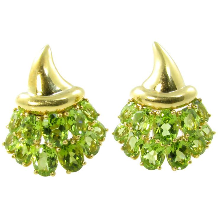 Verdura Peridot and Gold Cornucopia Earrings   From a unique collection of vintage clip-on earrings at http://www.1stdibs.com/jewelry/earrings/clip-on-earrings/