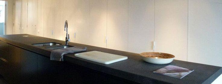 Totaal interior renovation of duplex flat, Damme, West-Vlaandere, Belgium  Mat black kitchen with white walls.