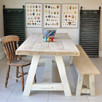 Beautiful chunky reclaimed pine table with breadboard ends and trestle legs. Hand made in England. Salvaged solid timber dining table has A shaped legs