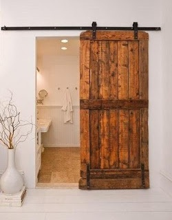 sliding barnwood doors. This is a great way for me to add a door to my master bath instead of doing a pocket door.