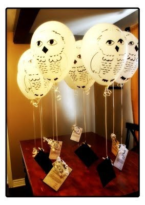 Owl balloons delivering invitations to a Harry Potter themed birthday party!