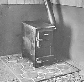Here are two low-cost approaches to safe wood stove installation. Originally published as