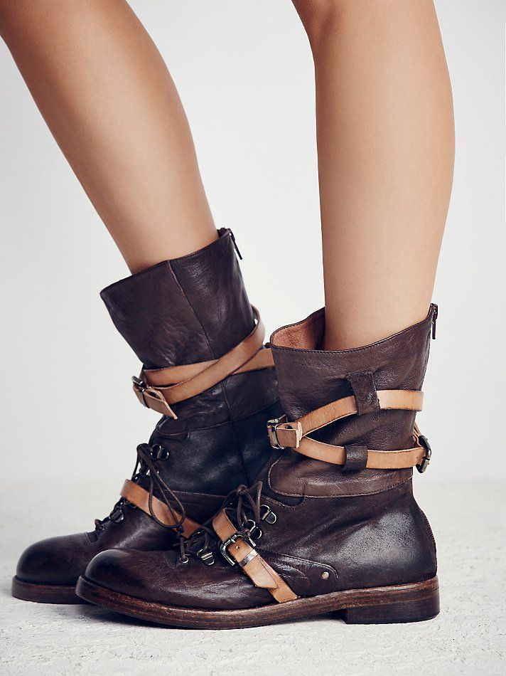 Into the Abyss Lace-Up Boot | Made from the finest Italian leathers this lace-up boot features contrast leather wrap detailing with buckle accents and a stacked heel.  Back zip for an easy on/off.