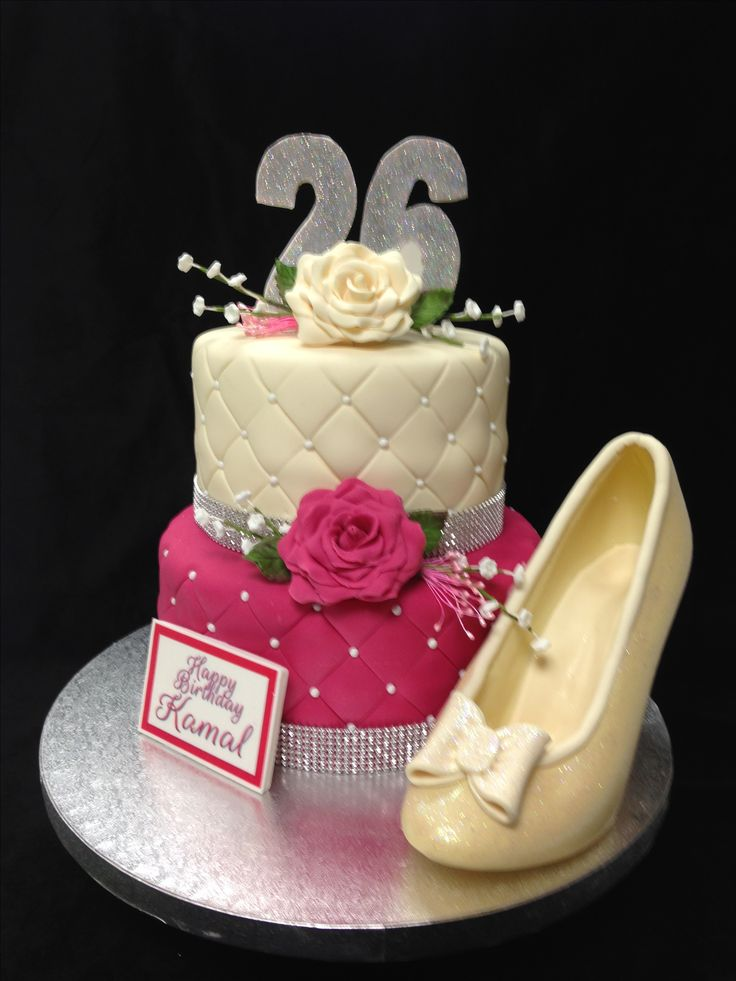 2 tier birthday cake with edible roses and white chocolate shoe.
