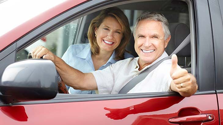 Happy Elderly Couple In Car Rental Car Discounts Car Rental