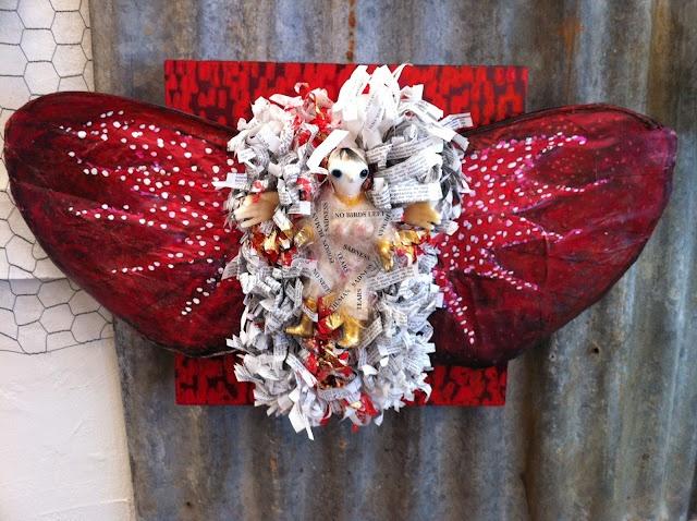Book, paper wings, wax hands, Porcelain Doll. Valerie Raven.blogspot.com