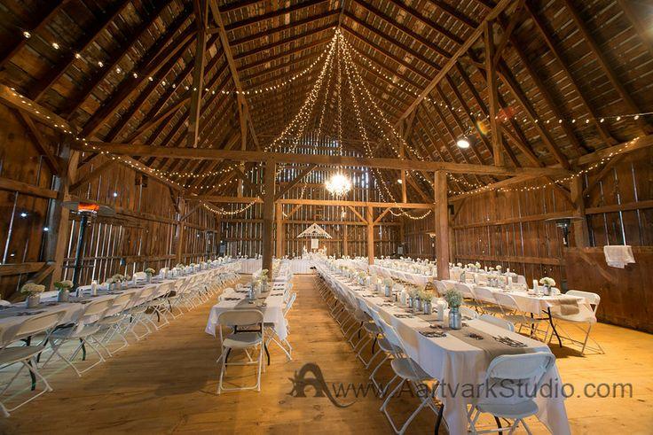 barn wedding venue reception lights chandelier banquet