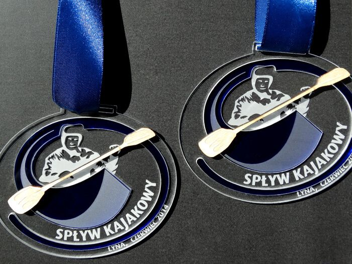 Medal sport at the Holiday kayaking. Plexiglass clear and blue transparent. Paddle with plywood.