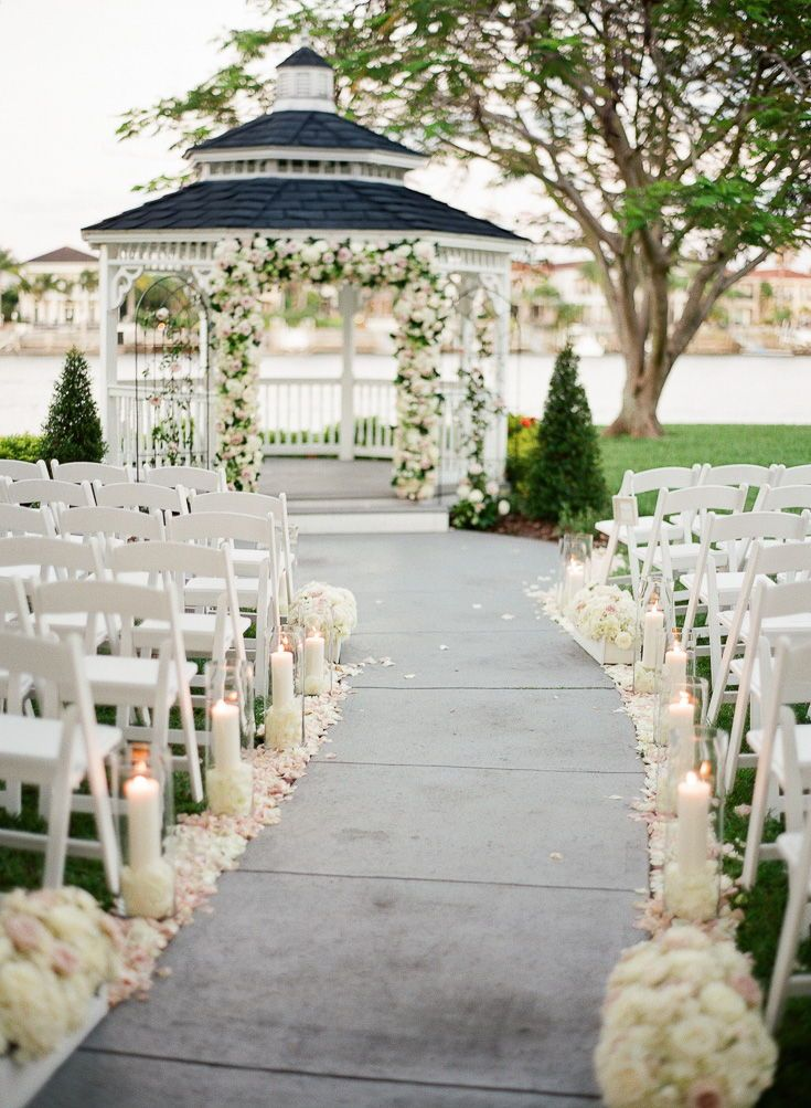 Unique Summer Wedding Ceremony Flower Arch On An Outdoor Gazebo