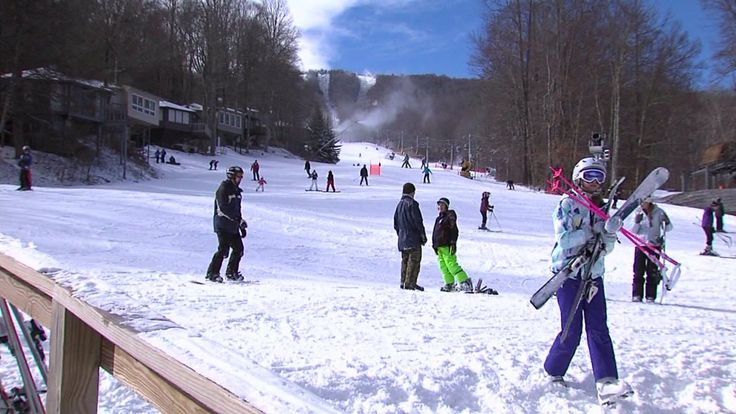 """SUGAR MOUNTAIN, N.C. -- Sugar Mountain Ski Resort in the Appalachian Mountains of Western North Carolina opened Sunday for skiing and snowboarding, the second earliest opening on record. """"It's exci..."""
