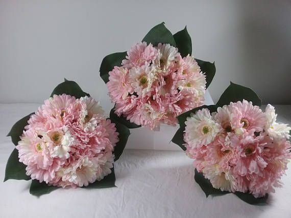 Gorgeous Pink Gerbra Bouquets for hand boquets or table arrangements Quality silk flowers  Listing is for $30.00 per Bouquet All my boquets are Hand made by me.  I have been a florist for 35 years and love my job.  I have sold Bouquets and wedding arrangements to the most remote parts of Australia, especially where fresh flowers are not available, and for those who want an everlasting keepsake of their special day. My faux flowers are made of quality products.  The items listed are one offs…