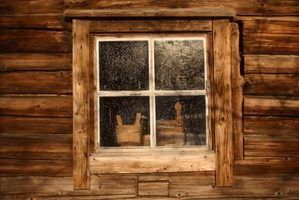 While most modern log cabins use custom-built windows, exterior trim helps blend these modern touches into the log walls. Description from ehow.com. I searched for this on bing.com/images