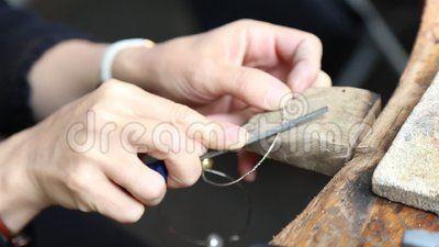Artisan woman - manual work at finery.
