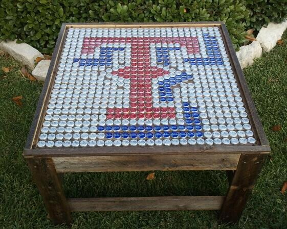 Texas Rangers Coffee Table - hand made from beer bottle cap and recycled fence pickets with glass top.  32 in x 32 in surface and 18 in tall  www.facebook.com/fienesour.stuff