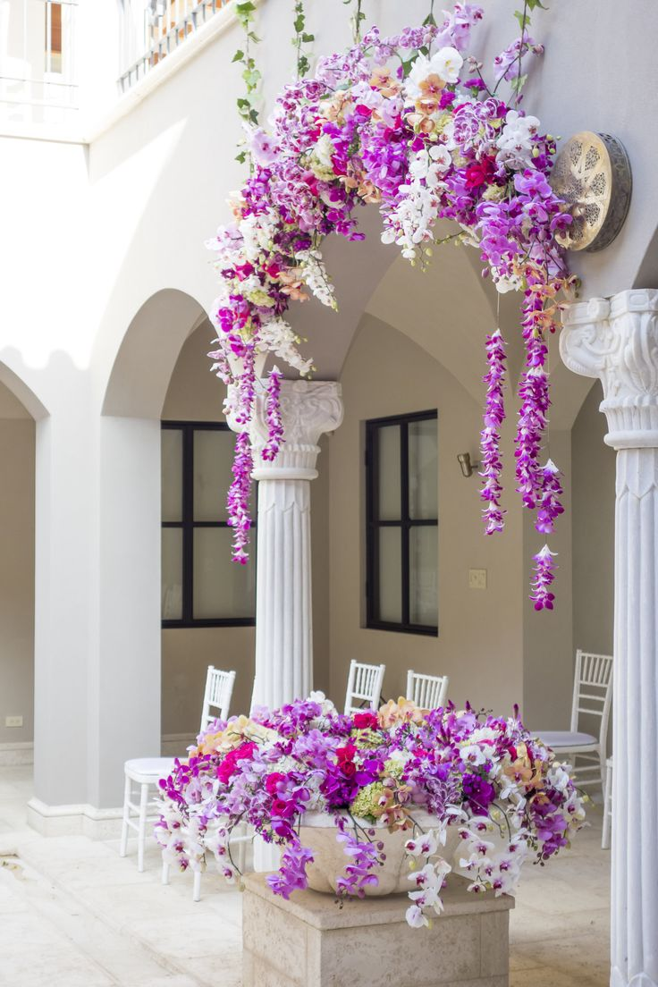 Orchids' petals hanging from arches