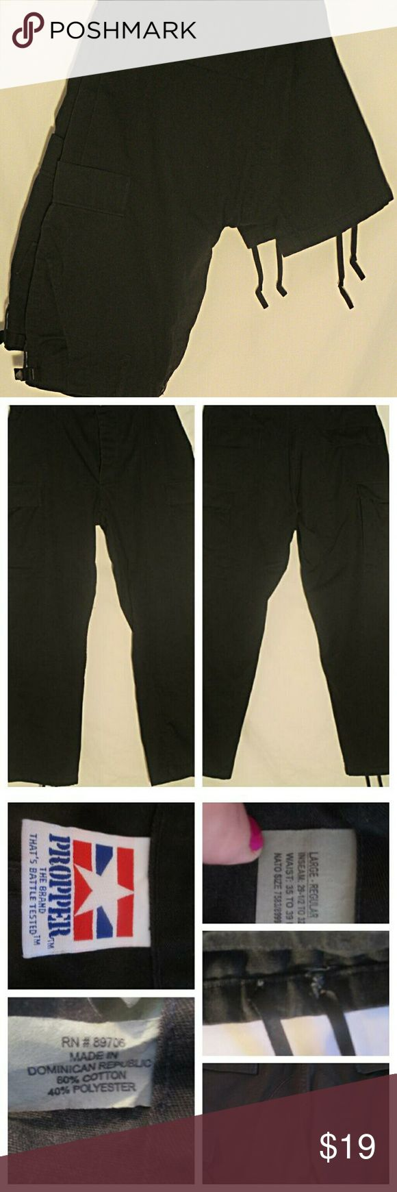 """Propper Black Tactical Pants EUC Sz LR Great looking pair of black tactical pants by Propped. Adjustable waist, button fly, reinforced butt, 6 pockets and drawstring cuffs. Stated size is LR. Measurements are 19"""" waist, 24"""" hips, 12"""" rise, 31"""" inseam, 8.5"""" cuffs, 44"""" outseam. All measurements are taken with the garment laying flat. Propper Pants Cargo"""