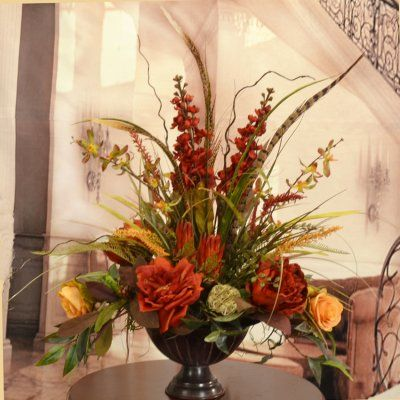 """Orchid, Rose and Feather Silk Flower Arrangement AR363 - Burnished reds and warm golds define this exquisite silk floral and greenery arrangement. Created with roses, stock, grasses, feathers, silk orchids and protea. Set in an attractive pedestal bowl, this breathtaking faux floral and feather design measures 24""""h x 18""""w x 13"""" D #silkorchids #silkflowers"""