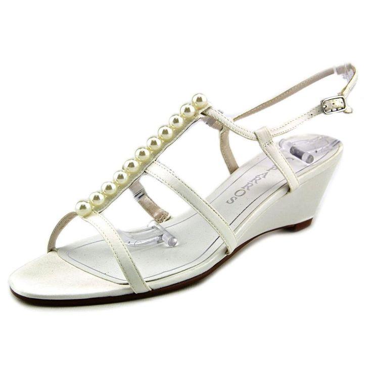 "Caparros Sullivan Women US 7.5 Ivory Wedge Sandal. The style name is Sullivan. The style number is S6817-IVY. Brand Color: Ivory (Main Color: Ivory). Material: Canvas. Measurements: 2"" heel. Width: B(M)."