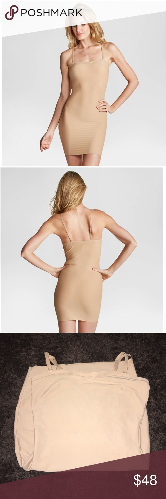 New beige Spanx body slip in Medium New without tags beige in Medium Assets by Spanx Micro Shaping Convertible Slip. This slip does it all! Lightweight, single-layer offers comfortable shaping all over! What's more? With removable, convertible straps, you can wear this slip 5 ways! • Lightweight, single-layer shaping -- all- over control • Removable, convertible straps – wear 5 ways! • Imported • 80% Nylon, 20% Spandex/Elastane Material: 80% Nylon, 20% Spandex, Closure Style: Pull on SPANX…