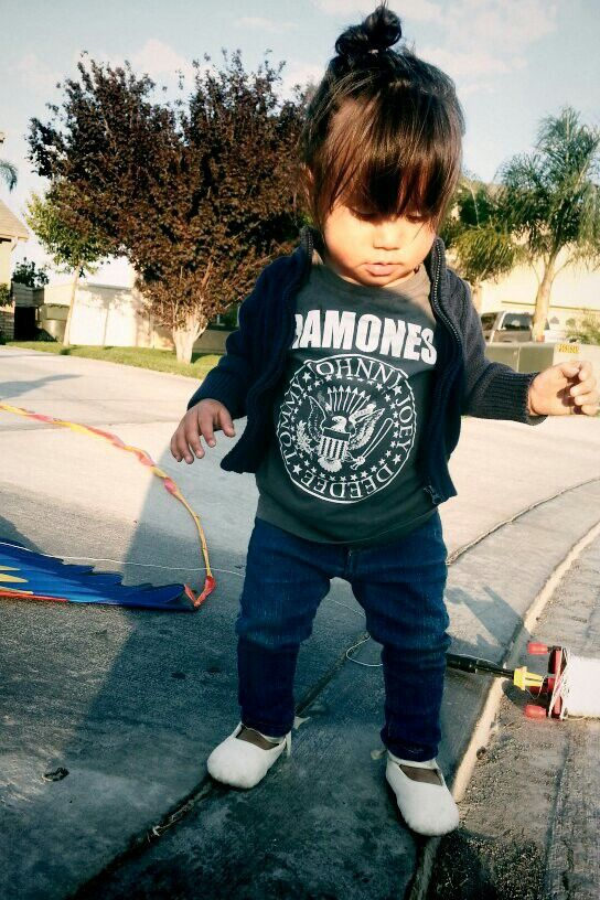 The marvelous Moon Child rockin' her blue knit cardigan over a Ramones tee, paired with skinny jeans and cutesy ballerina slippers... Did i mention how cute her messy bun is?  #workit #ramones #kids #punk #fashion #punkkid #rocker #radness