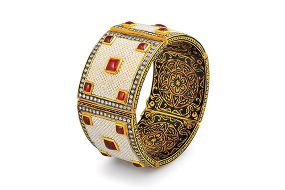 A beautiful gold, enamel, pearl, ruby and diamond Indian bangle.