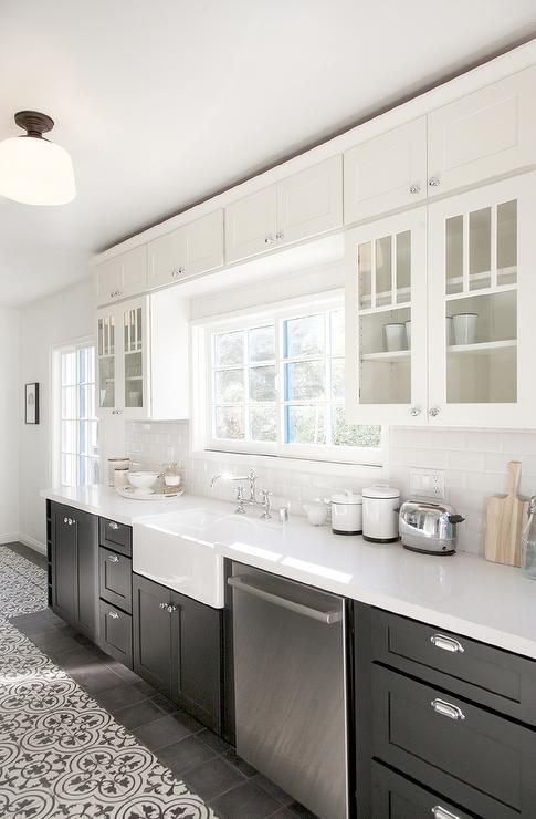 Vintage modern kitchen design featuring white upper cabinets, black (charcoal gray) lower cabinets, and white cement bouquet III patterned floor tiles - Kitchen Ideas & Decor - decor pad.com