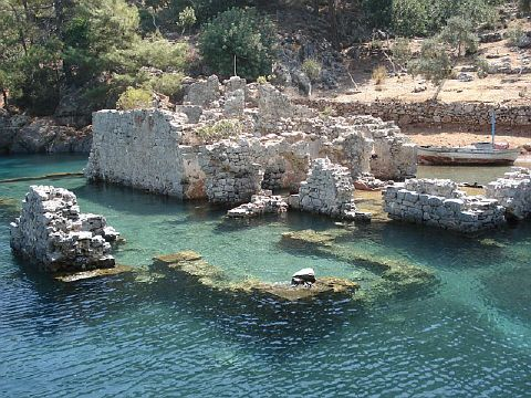 Turkey - Kekova, Cleopatra's Bay (Manastir). Three miles from Tomb Bay. Another exquisite setting with thick pine right to the water's edge. Half submerged ruins dating from about AD 1100 may be what remains of an Orthodox monastery (thus, Manastir). I swam in those waters when I lived in Göcek.