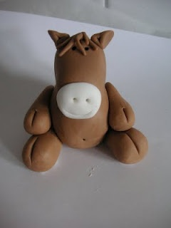 How to make a fondant horse. It'd be cute to make all the toy story characters for either a cake or cupcakes