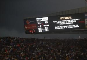The Bears-Ravens game at Soldier Field in Chicago was temporarily suspended with 4:51 left in the first quarter because of inclement weather, with tornado warnings placed on parts of seven Midwestern states, including Chicago.