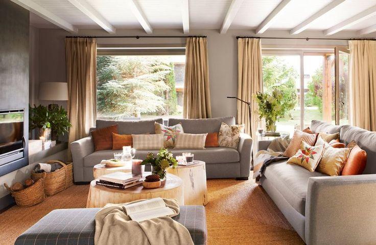 Combinație de gri cu bej într-o casă destinată relaxării
