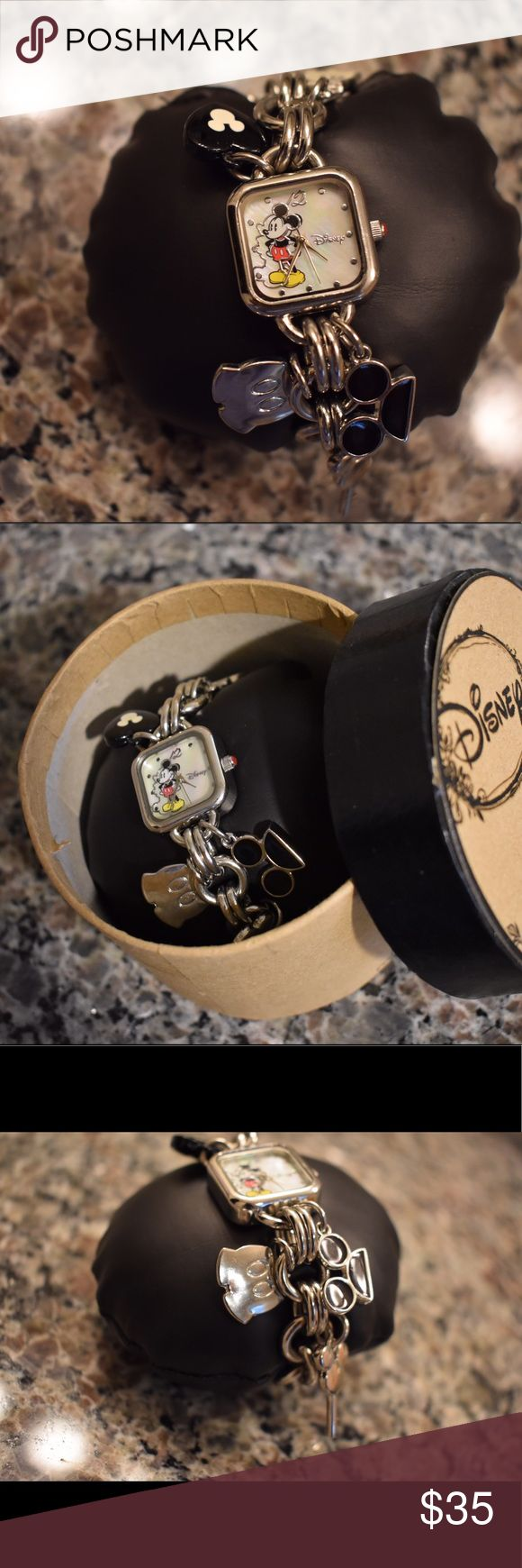 Disney square Mickey Mouse watch A cute and fun Mickey Mouse square silver watch with Mickey Mouse charms! It snaps shut! It is in brand new condition with all packaging and has only been worn a couple of times! Disney Jewelry Bracelets