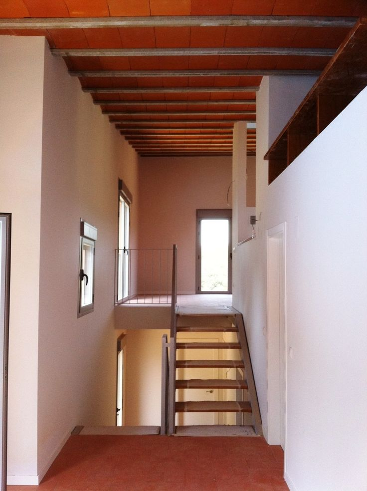 A light metal+wood stair linking levels